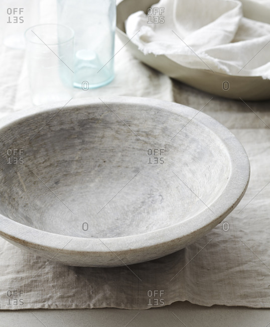A white bowl on a white table