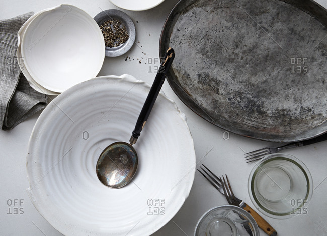 White bowls and a metal serving platter