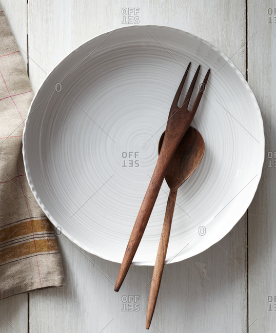 Wooden utensils on a white plate