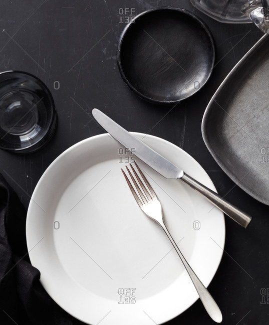 A white plate and black bowl