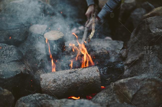 Camper starting a campfire
