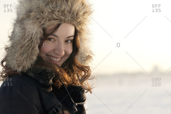 Woman smiling in furry hat