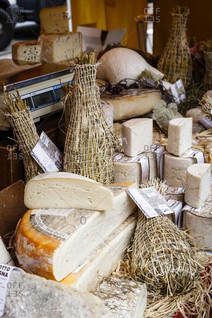 Piedmont, Italy - October 19, 2013: A cheese stall at a market in Alba, Langhe, Cueno, Piedmont, Italy