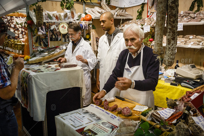 Piedmont, Italy - October 19, 2013: A salami stall at the Truffle Fair in Alba, Langhe, Cueno, Piedmont, Italy