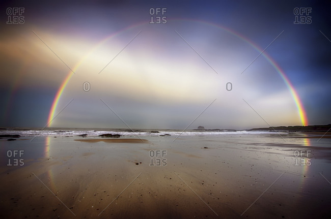 View of rainbow from beach