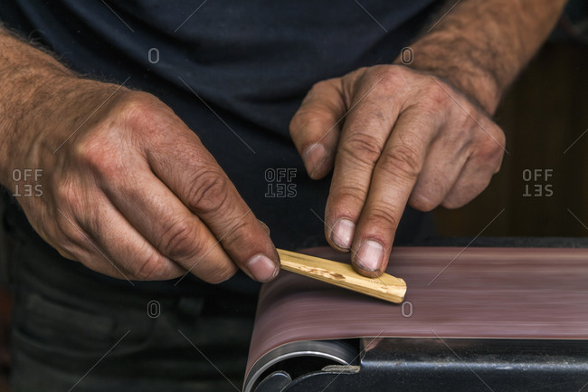 Knife maker in workshop at work