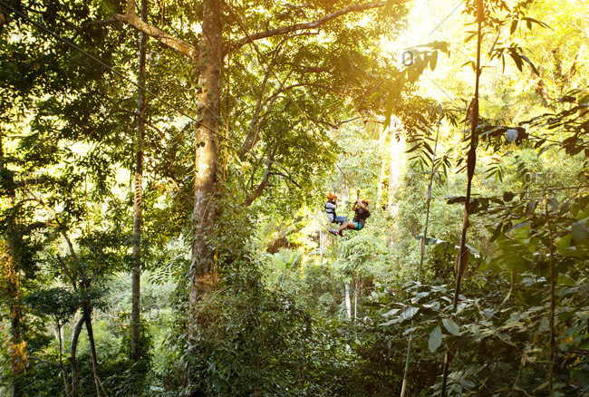 Two people zip-lining in Thailand