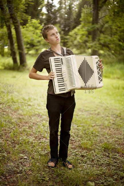 A boy plays an accordion
