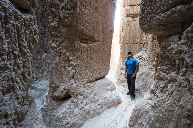 Hiker in slot canyon in Cathedral Gorge State Park