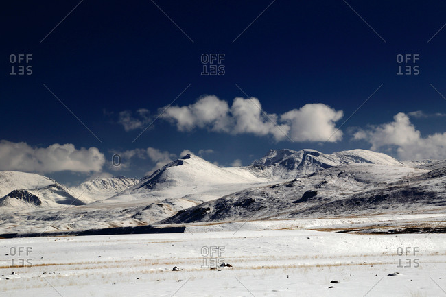 Snow covered prairie and mountains