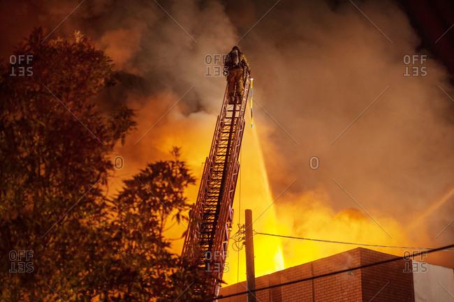A fireman fights a fire