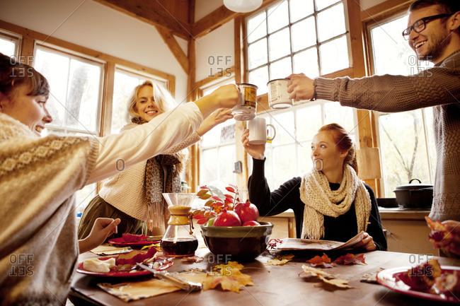 Four friends share a toast