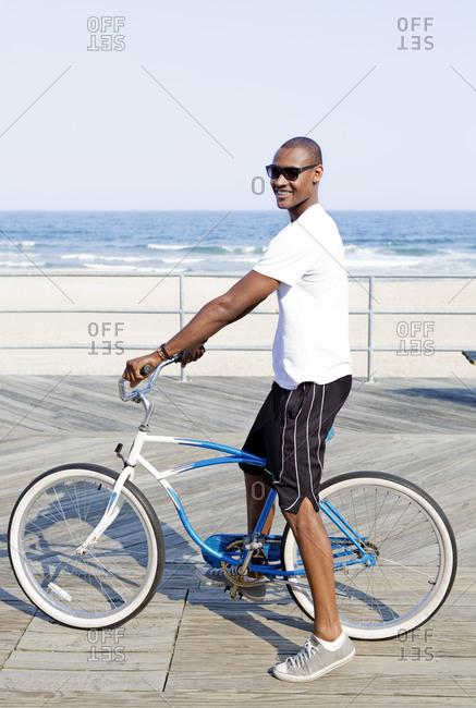 A young man on a beach cruiser