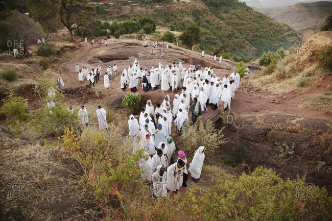 Lalibela, Ethiopia - December 19, 2010: A funeral procession at The Church of Saint George, Lalibela