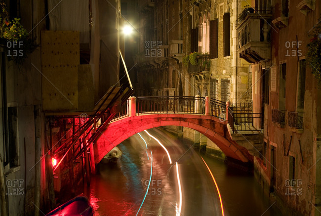 Narrow canal with bridge in Venice
