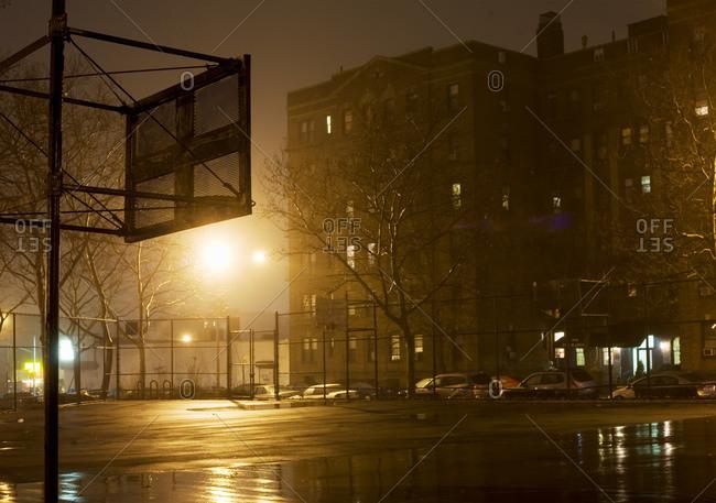 City basketball court at night