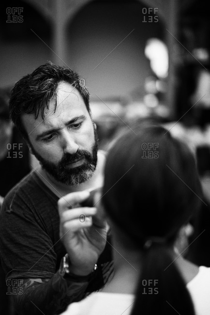Sibiu, Transylvania, Romania - September 5, 2014: Man applying makeup for fashion show
