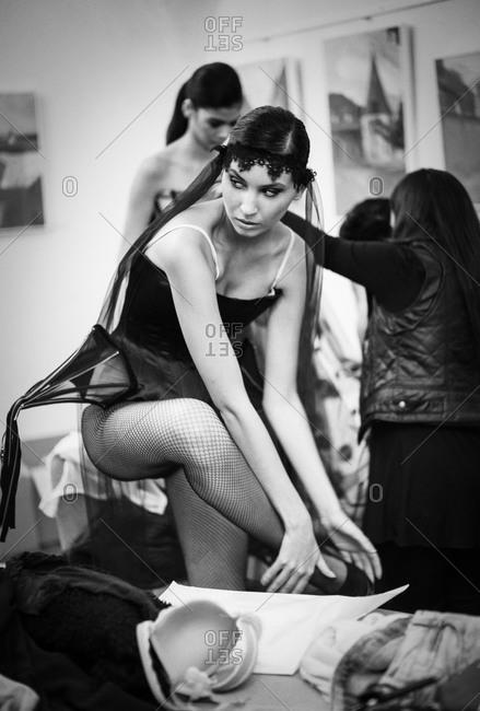 Sibiu, Transylvania, Romania - September 5, 2014: Model getting dressed for runway show
