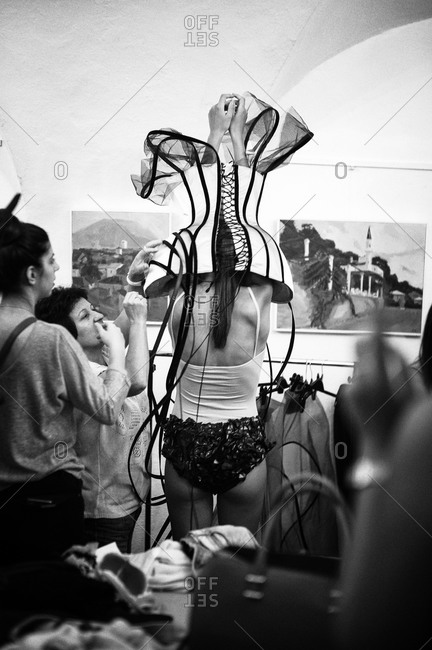 Sibiu, Transylvania, Romania - September 5, 2014: Model putting on outfit for runway show