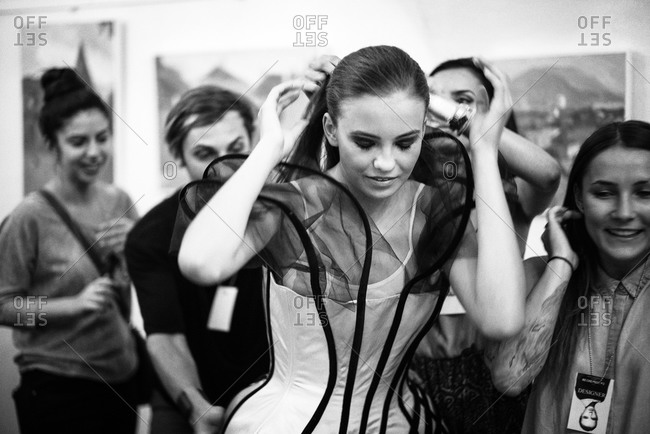 Sibiu, Transylvania, Romania - September 5, 2014: Model getting hair adjusted for runway
