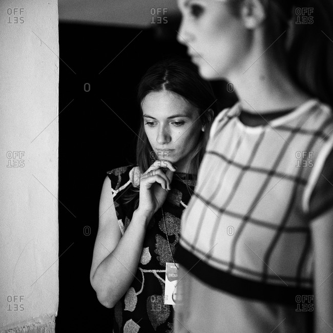 Sibiu, Transylvania, Romania - September 5, 2014: Model and assistant backstage waiting