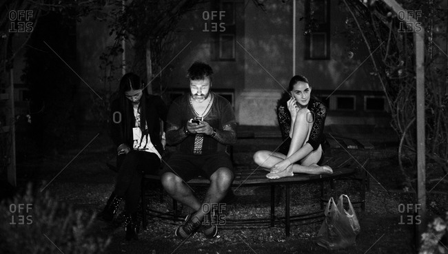 Sibiu, Transylvania, Romania - September 5, 2014: Models and assistant using phone backstage