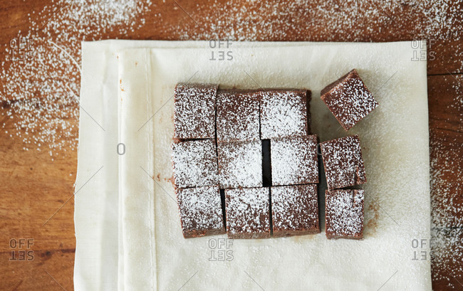 Pieces of brownie squares with powdered sugar