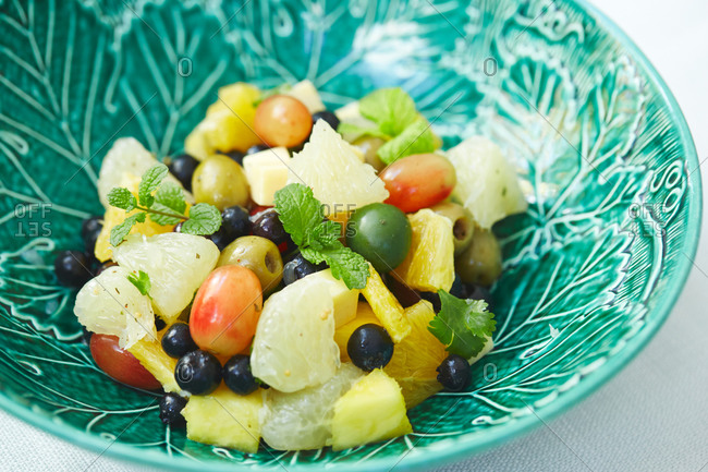 Fruit salad with mint and olives