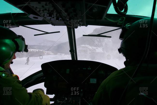 Corvara, Italy - February 11, 2009: Italian servicemen active in the Folgore Parachute Brigade participate in a drill in Corvara, Italy