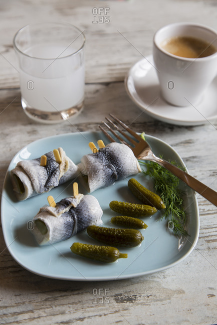 Dish of rollmops and pickled cucumbers, black coffee and fizzy tablet