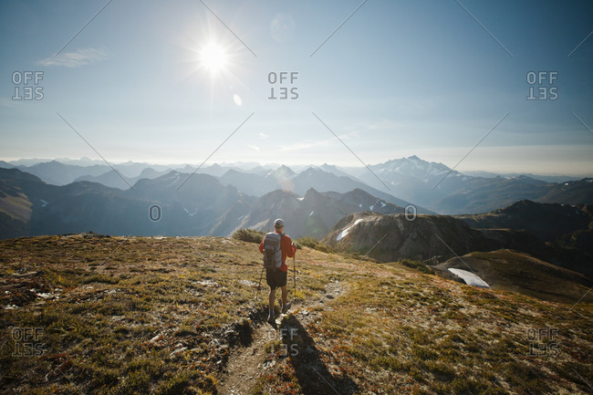 Man hiking down a slope in North Cascades National Park