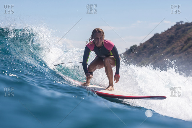 Girl surfing a wave