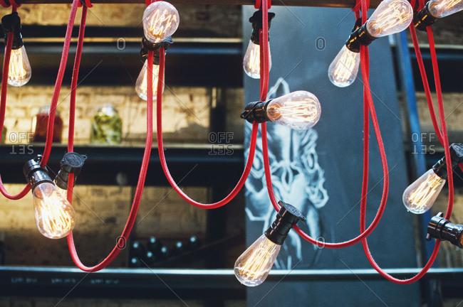 Filament light bulbs hanging from a red cord