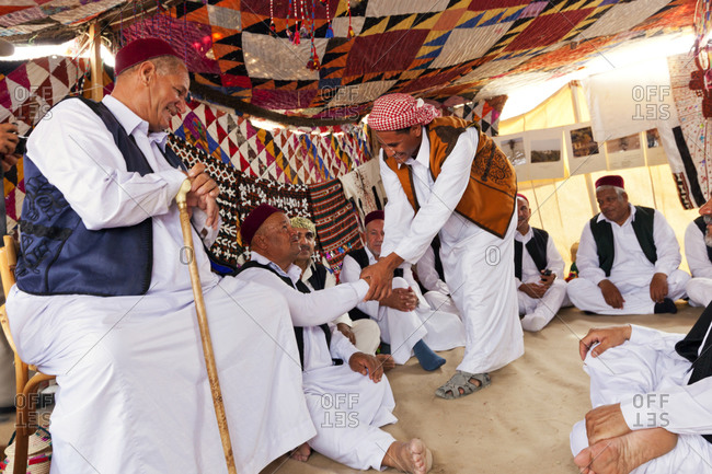 Men greeting each other at the Siwa Festival in Egypt