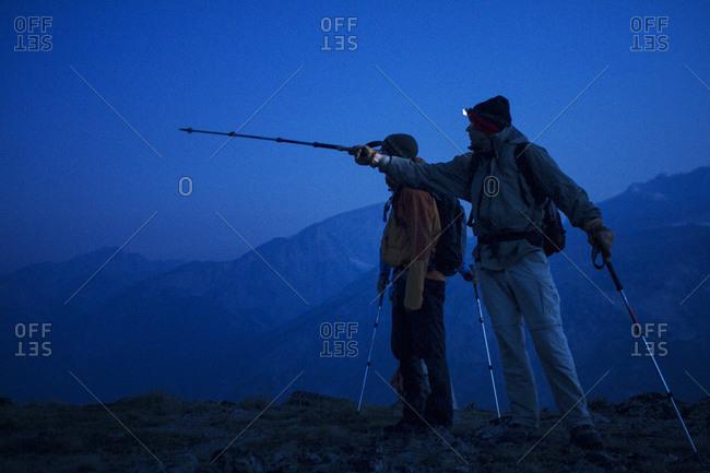 Two men hiking at night