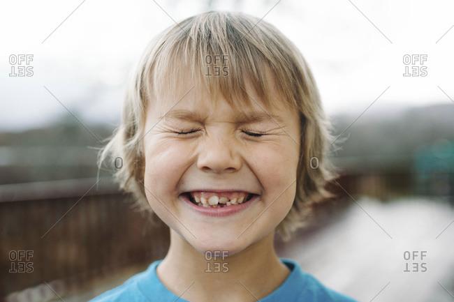 Portrait of blond boy squinting