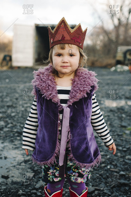 Girl wearing crown outside in fall