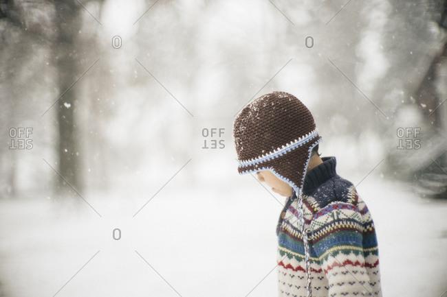 Boy in crocheted hat in snow