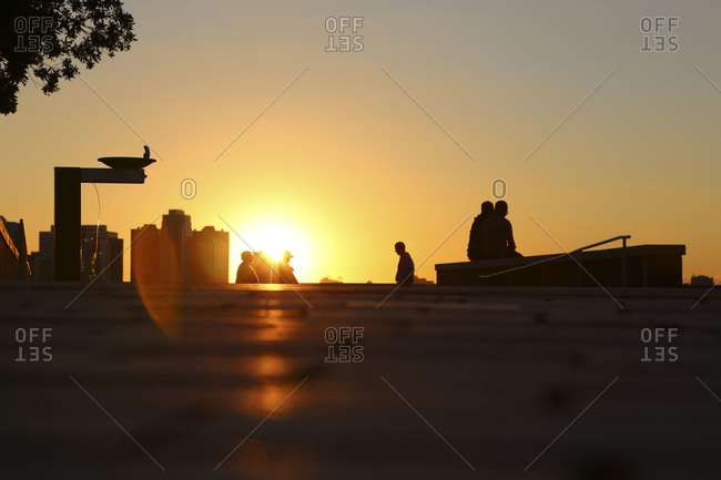 Sunset over paved park