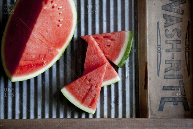 Sliced watermelon on a washboard surface