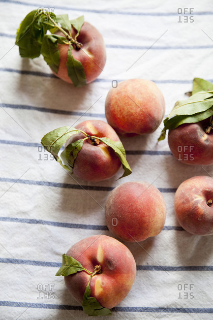 Peaches on a blue and white striped napkin