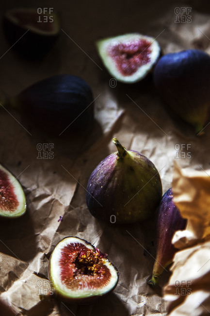 Sliced figs on a piece of butcher paper