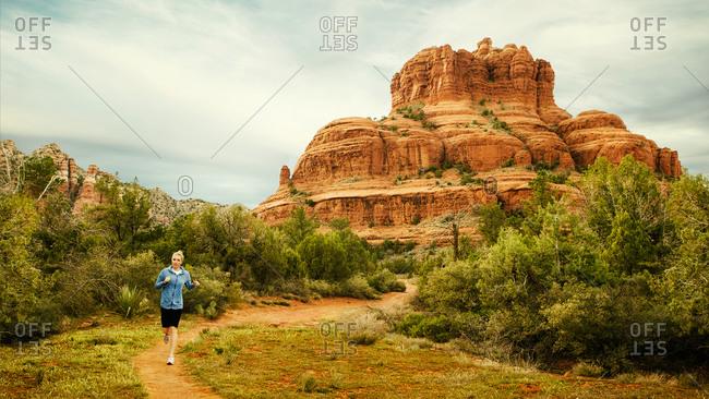 Runner jogging on a desert trail