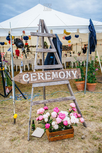 A sign points in the direction of a wedding ceremony