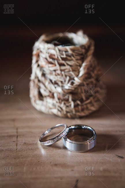 Wedding rings in front of a straw basket