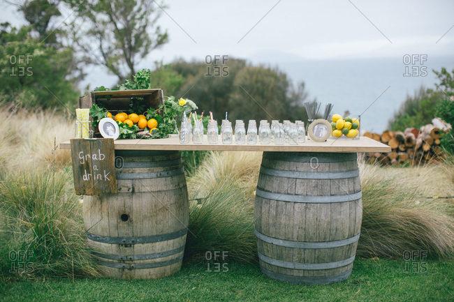 A drink stand set up on barrels
