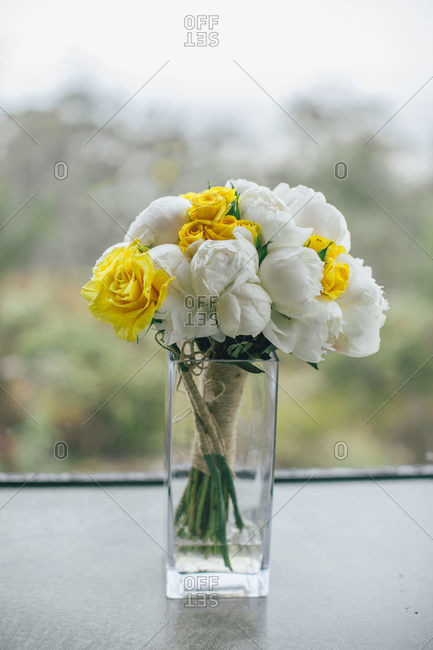 A simple bridal bouquet of white and yellow roses