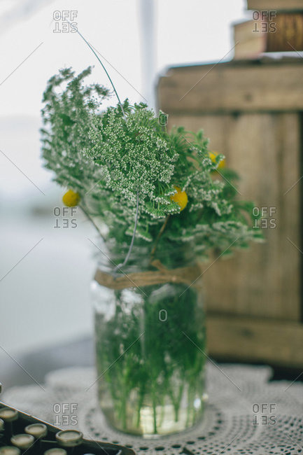 A mason jar filled with wildflowers