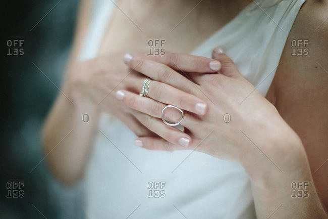 A bride locks her fingers over her heart