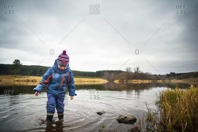 Young Boy stepping in a River